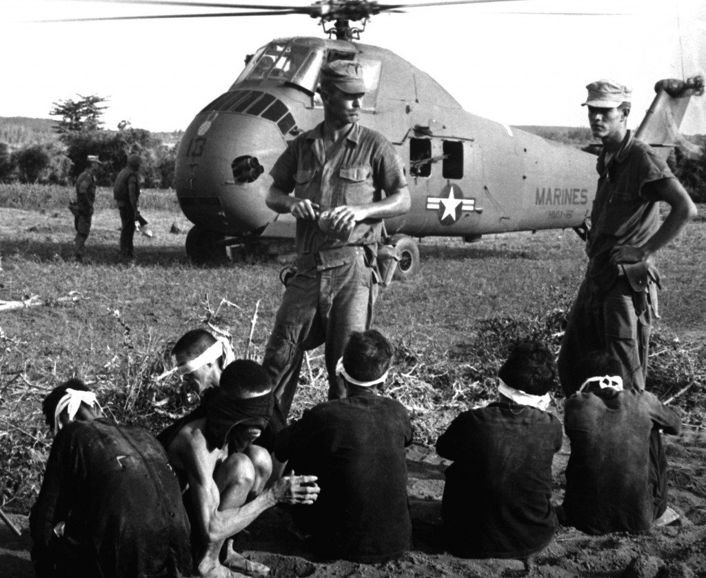 Operation Starlight, a U.S. Marine Corps search and destroy operation south of Chu Lai. VC casualties stood at 599 killed and six captured. Viet Cong prisoners await being carried by helicopter to rear area. August 1965. JUSPAO. (USIA) EXACT DATE SHOT UNKNOWN NARA FILE #: 306-MVP-21-2 WAR & CONFLICT BOOK #: 415