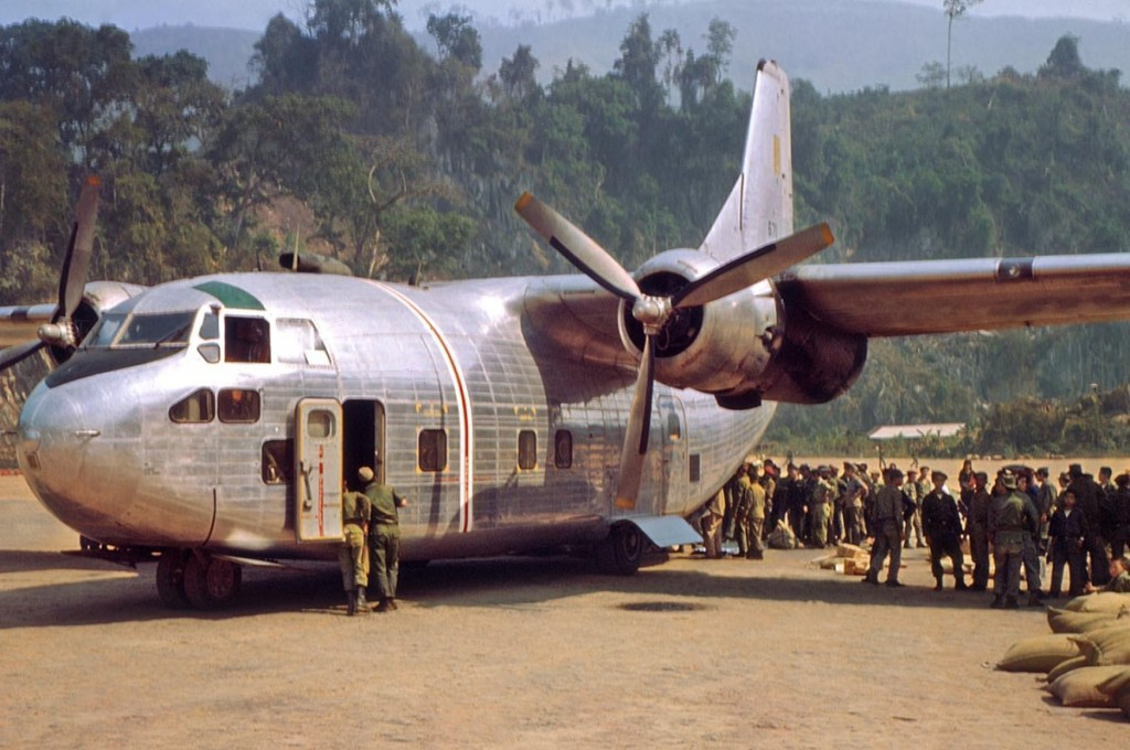 An-Air-America-C-123-delivering-supplies-and-picking-up-Laotian-troops-at-Long-Tieng.-RLW