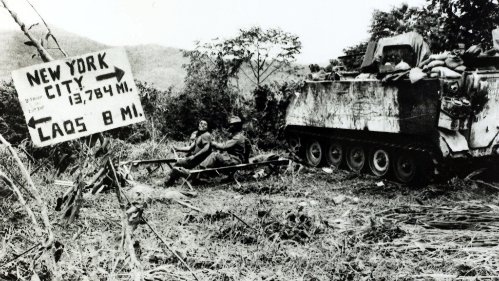 War and Conflict, The Vietnam War, near Khe Sanh, South Vietnam, pic: circa 1968, American soldiers close to the Laos border with a board reminding them of their long distance from home (Photo by Rolls Press/Popperfoto/Getty Images)
